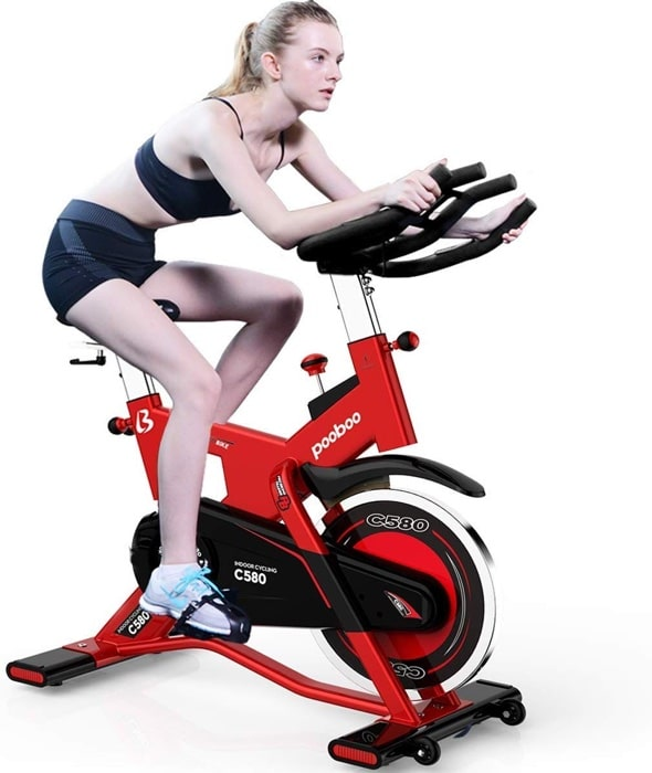 a woman rides the Pooboo Commercial Stationary Bike