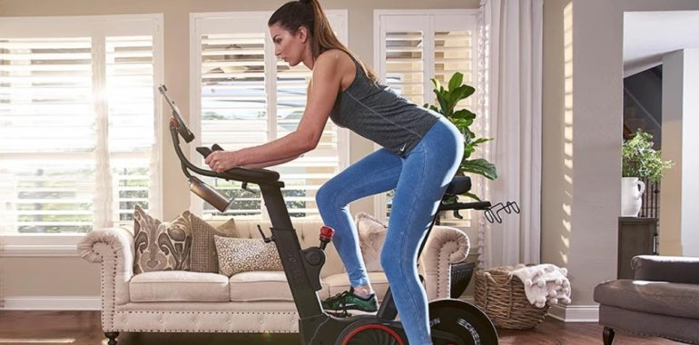 a woman rides the Echelon Smart Connect