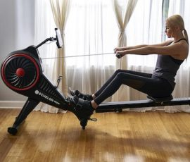 woman uses the smart rowing machine