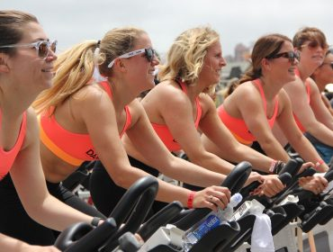women ride exercise bikes to lose weight