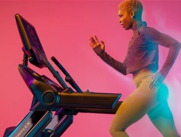 a woman runs on the new Bowflex 22 treadmill for our review