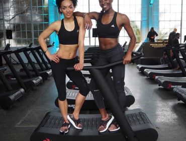 women on the trueform runner treadmill