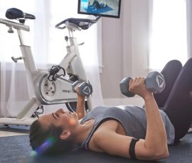 a woman workouts out while comparing myx to peloton