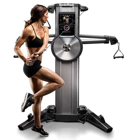a woman works out on the NordickTrack Fusion CST