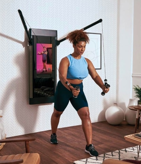 a woman working out at home on the Tonal