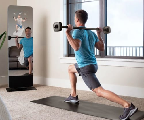a man takes part in an iFit workout