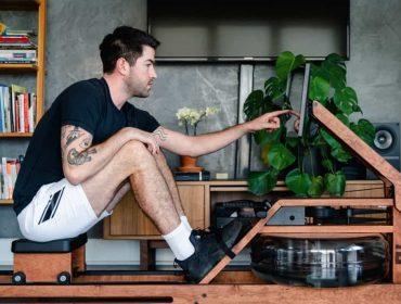 a guy choosing his favorite Ergatta workout